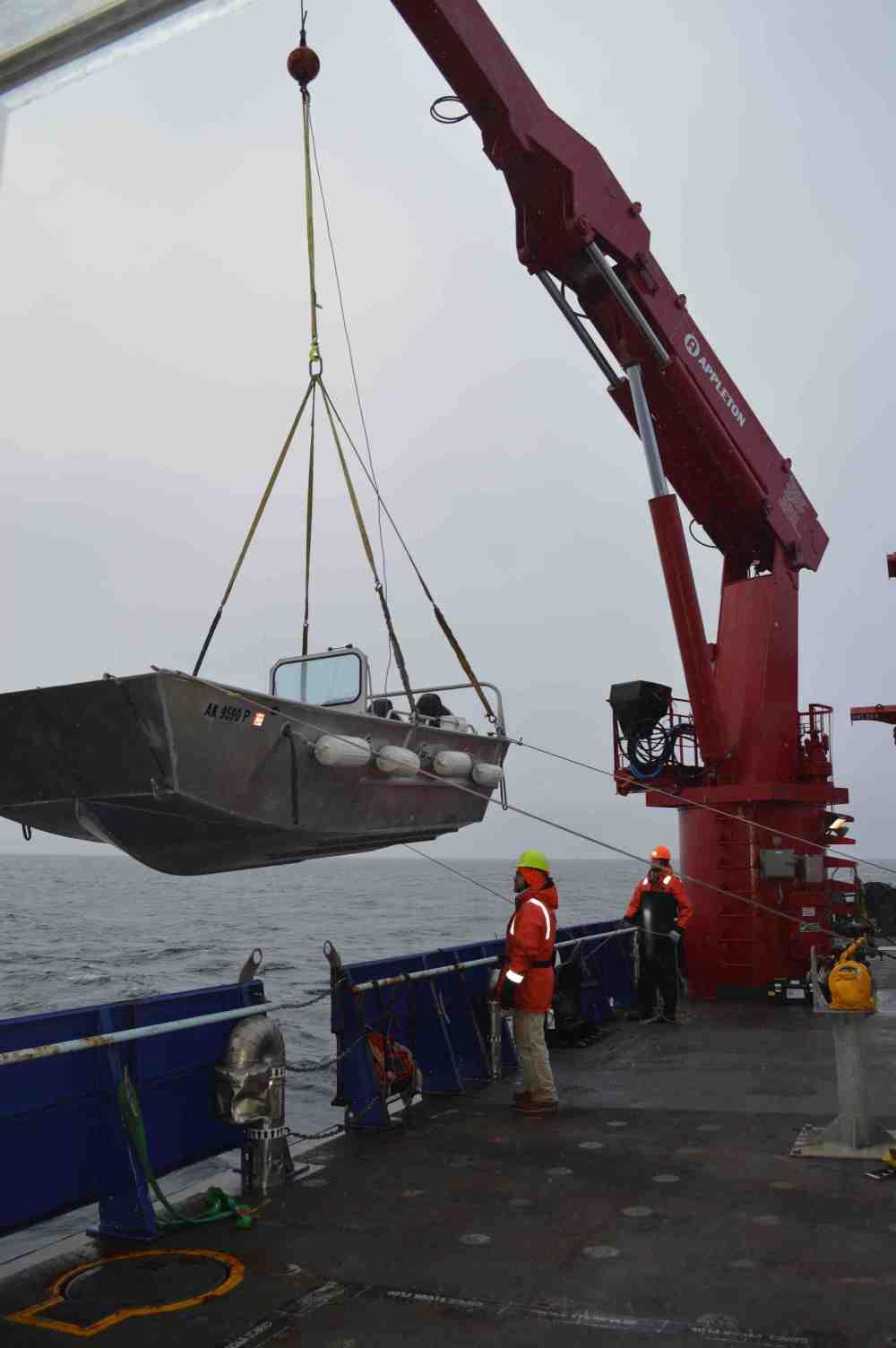 Crane boat over edge.jpg
